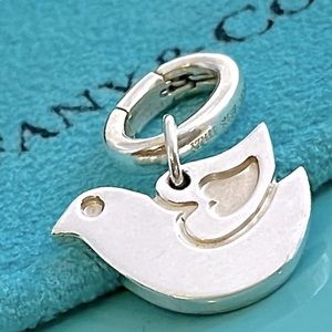 ISO (to buy) TIFFANY & Co Dove necklace or charm